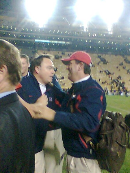Head coach Houston Nutt, and OC Kent Austin celebrate the win.