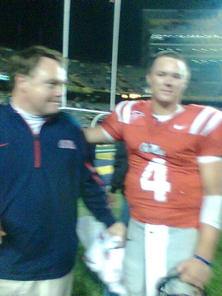 Houston Nutt and Jevan Snead before a TV interview.